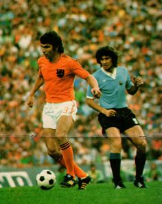 Holland 2 Uruguay 0 in 1974 in Hannover. Wim Van Hanegem brings the ball out of defence in Group C at the World Cup Finals.