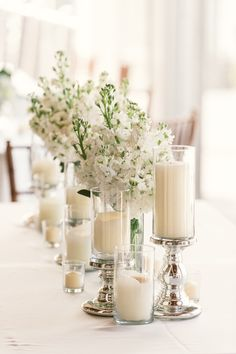 White and candles. Coordinator: Creme De La Creme Events   Florist: Anthology Floristry. Photography: Anne Liles - www.annephoto.com Read More: http://www.stylemepretty.com/2014/08/14/elegant-island-yacht-club-wedding/