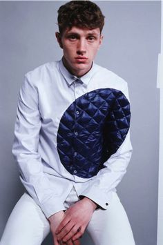 """Martine Rose, pinstripe shirt with quilted nylon circle, Fall 2009 """"Pieces' collection. Promotional image."""
