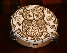 Tambourine decorated with a cute henna owl and by RedwoodHenna