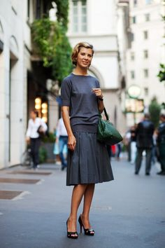 The Best of Milan- quality, elegance, maturity, and refinement.   On a street blinged-out on Cavalli and Dolce this super subtle look carried more strength and dignity than any other - The Sartorialist