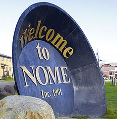 DONE = the 'Welcome to Nome' gold - panning sign --- there upon entering the village