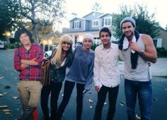 Miley Cyrus, Liam Hemsworth, and a couple of fans with.... a Harry Styles cardboard cut out.