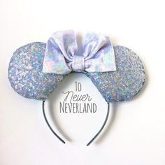 Holographic Mickey Ears, Holographic Minnie Ears, Iridescent Mickey Ears, Silver Iridescent Mickey Ears, Custom Mickey Ears, Holographic Silver Minnie Ears Be a part of the magic with these handmade, Disney inspired holographic ears! The base of the ears is a holographic iridescent silver sequin fabric. They are finished with a silver holographic velvet bow. The headband itself is silver glitter. There are SO SPARKLY!!! One size fits most!  A note about the general size, fit, and weight of…