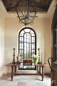 Cream Mountain Foyer with Arched Window
