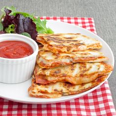 Pepperoni Pizza Quesadillas Serves 4 8 flour tortillas (I used Trader Joe's handmade tortillas) 8 ounces of shredded mozzarella cheese 1/3 lb pepperoni 1 16-ounce jar of pizza sauce Optional: 1 6-ounce can of sliced black olives, 1 cup of sliced cremini mushrooms