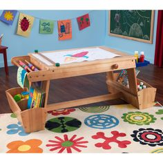 Keep little hands busy painting, drawing, and coloring for hours with this wooden art table for kids. This solid wood table encourages creativity and is equipped with a drying rack and lots of storage for art supplies and other items.