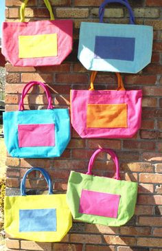 Colorful jute tote bag with contrasting front pocket by SoBlank
