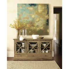 I'm using this as a medial table.  The TV looks beautiful hung above it.  And I can place books and other decor underneath.  The glass allows my remotes to work with the doors closed.    Belgard Cabinet