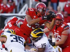 Utah running back Devontae Booker (23) dives over the pile for touchdown during the second quarter against Michigan in Salt Lake City. Booker and the Utes won 24-17 in the season opener.  Jeffrey Swinger, USA TODAY Sports