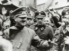 Hitler, followed by his SS bodyguard Bruno Gesche, receiving flowers from Sudeten Germans as he enters the Sudetenland, October 4, 1938