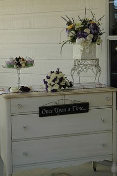 Wedding on the front porch--refinished chest used as cupcake table.