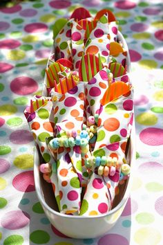 Use candy bracelets to wrap plastic cutlery at a candy themed birthday party.   Tons of great candy ideas in this post...