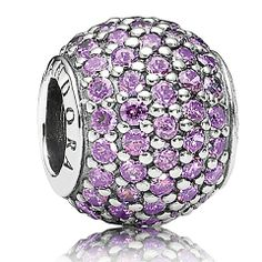 New for Winter 2013 is this stunning purple pave ball charm from PANDORA. With its number of sparkling purple cubic zirconia scattered over the sterling silver bead, this bead is sure to add glamour to any outfit or charm collection.