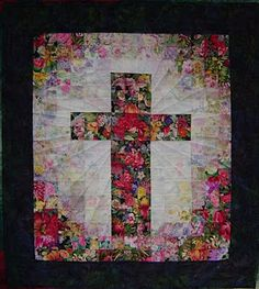 This post is about Easter Resurrection Rolls, but I loved the cross quilt wall-hanging. :D