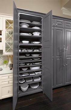 entertainer's dream storage cabinet awaits you. Ample shelves in this pantry from Omega Cabinetry provide all the space you need to store each of your serving dishes without a lot of stacking. Custom Bathroom Cabinets, Small Kitchen Cabinets, Gold Kitchen, Kitchen Cabinet Organization, Kitchen Cabinet Design, Kitchen Redo, Custom Cabinets, Kitchen And Bath, New Kitchen