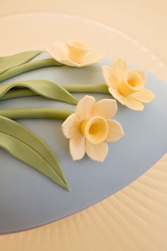 Easter egg shaped cake decorated with daffodils