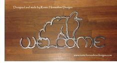 Welcome sign with a horse head wearing a halter incorporated into the word.  Designed and made by Rustic Horseshoe Designs.