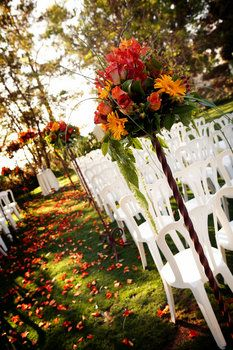 Love the fall leaves down the aisle instead of flower petals