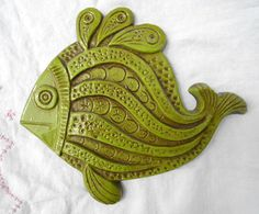 "Hippie Wall Plaque. Not sure why it's described as ""hippie"" but I really like this. It's a happy fish. I think it would be stronger with a bit more color variety."