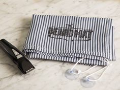 Keep your bathroom clean when you trim your beard, mustache, or hair. This three-foot square non-stick fabric attaches to your mirror and covers the sink and countertop while you're grooming. When you're done, the hairs slide off the nonstick surface and into the trash. No more hair everywhere.