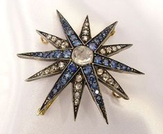 Diamond and sapphire star brooch.