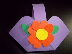This is an easy and fun craft for your kids which will teach them how to make a small basket out of construction paper. You can use it to hold candies, flowers or any other small children's articles. You just need some brightly colored paper, scissors, glue and a stapler.