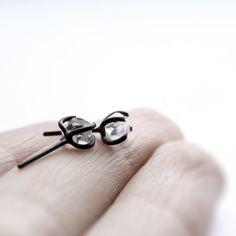 Xx . herkimer diamond oxidized sterling silver post earrings. $60.00, via Etsy.