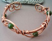 Wire wrapped copper and green beads bracelet adjustable size.  diameter 3 inch - 8 cm approx  Every jewel are handmade and unique,  all items will come packed in a nicely jewel cardboard box, perfect for your gifts.    You can find more Steampunk & Retro-Future creations on http://www.etsy.com/shop/GearsFactory    See Shop Policies if you would like to know more about my creations  and for the terms & conditions.    Shipping for USA via Priority Mail can take 10 da...