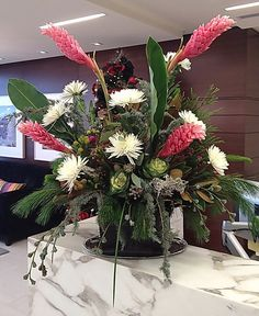 A funky twist on a Christmas or holiday arrangement. Christmas floral ideas, funky flower ideas.