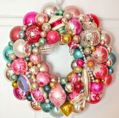 gorgeous holiday wreath made of ornaments, love the colors