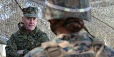 Then-commandant of the Marine Corps Gen. Joseph F. Dunford, Jr., speaks to Cpl. Allison M. Devries, Ground Combat Element Integrated Task Force, about the future of the Corps, Feb. 3, 2015.