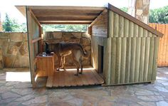 This awesome log cabin style dog house has its own little porch area complete with doggy dining table!
