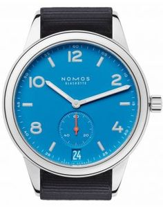 NOMOS GLASHÜTTE CLUB AUTOMAT DATUM SIGNALBLAU    Club is in a league of its own. Reduced to the essentials, robust by nature. Now with a few differences typical to the Aqua series from NOMOS Glashütte: a blue that fell from the sky, a feeling of a never-ending summer for the wrist—and it is suitable for diving, water resistant to 20 atm, so 200 meters. Whether a few leagues under the sea, or in the dark of night, superluminova illuminates the time. All the while NOMOS caliber DUW 5101 turns…