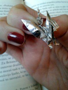 Little origami dragon made out of chocolade wrapper :) http://www.arsorigami.com/