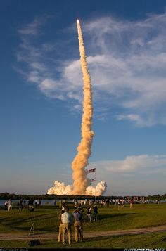 June 8, 2007. Space Shuttle Atlantis is a small tip on the trailing column of fire and smoke after launching on its journey to the International Space Station on mission STS-117. Liftoff from Launch Pad 39A was on-time at 7:38:04 pm (EDT). Wide angle view allows you to spot the famous countdown clock at the bottom of the frame. This is where we called a 'Press Site' being located 3.2 miles from the Pad 39A - Photographer Jean AirTeam Images