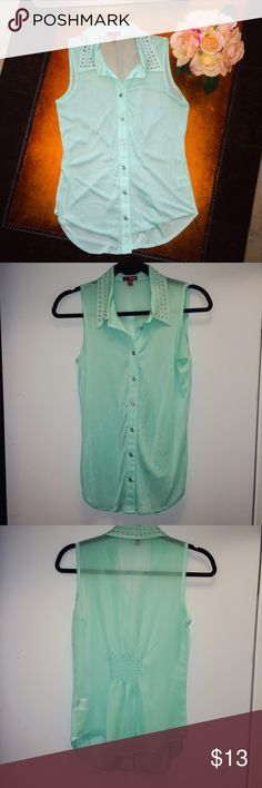 Green studded neck button down top. Green studded neck button down top. Very light shirt that looks great with skinny jeans or white shorts. Size S. See through back. BONGO Tops Button Down Shirts