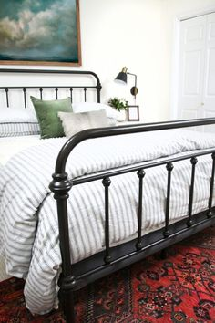 That's a Wrap on Guest Room modern farmhouse bedroom design with iron bed and ticking stripe bedding with oil painting, rustic farmhouse master bedroom Master Bedroom Design, Home Bedroom, Bedroom Furniture, Bedroom Decor, Bedroom Designs, Bedroom Ideas, Master Suite, Bed Ideas, Cottage Bedrooms