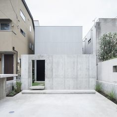House in Daizawa is a minimalist house located in Tokyo, Japan, designed by Nobuo Araki. Situated in a calm residential area of Setagaya, Tokyo, the rectangular house faces southward, with a garden at the rear. Several meters in front of the house, a concrete wall has been constructed to provide sufficient privacy to the glass-façade house, while retaining a sense of openness. (1)