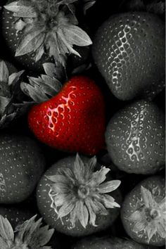 This photo shows emphasis because the background is gray and the only colored thing is the strawberry in the middle and it puts extra emphasis on it and makes it stand out.