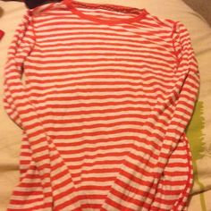 Orange striped long sleeve shirt It is in great condition, no stains, holes etc. never worn so it's like new American Eagle Outfitters Tops