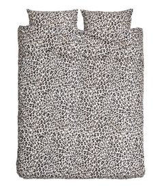 Light gray/black. King/queen duvet cover set with a printed leopard pattern. Duvet cover fastens at foot end with concealed metal snap fasteners. Two