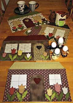 """Quilted tablemats - houses; would look cute hanging from my """"Welcome"""" hanger in entryway."""