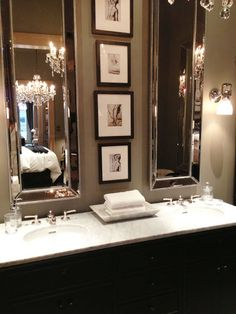 slim beautiful mirrors that allow for art (or a beautiful storage tower). Love The whole look it's Glam, posh hotel, escape.