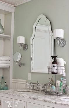 Lowes venetian arch mirror with home depot waterton sconces in DIY master bathroom