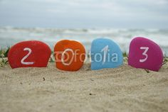 2013 new year on colourful stone letters with coast background