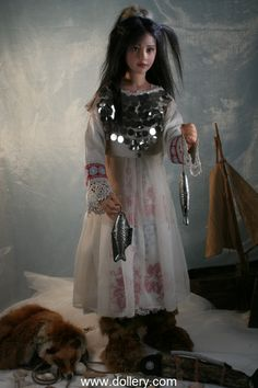 Rotraut Schrott.Fisher Girl The doll is made of Cernit/Modelen She has fabric body with armature, approximate size 41 1/2 inches (105 cm) Her wig is long black human hair.  Her eyes are painted brown.