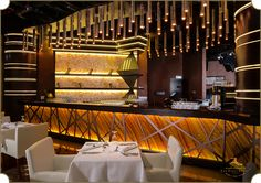 Kiza, DIFC, Dubai an endeavor to create artistry in a bar design with an African inspired theme and an exclusive bamboo lighting fixture built for the space.  By #TheFirstFerry  #InteriorDesign #Bar #Artistry #Luxury #Interiors #Lounge #Restaurant #Dubai