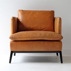 Gorgeous leather armchair in a modern but classic look, love this piece!