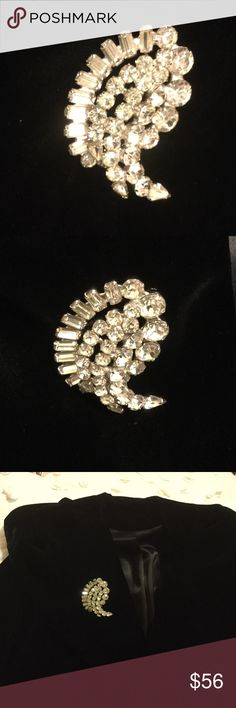 """VINTAGE KRAMER SIGNED PIN VINTAGE KRAMER STUNNING Pin with encrusted emerald cut stones on bottom, medium rounds in the middle, and large round stones along the upper edge. The pointed area has 2 teardrop rhinestones. Signed """"Kramer"""". Large in size. KRAMER Jewelry Brooches"""